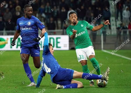 Saint-Etienne's Arnaud Nordin, right, duels for the ball with Gent's Alessio Castro-Montes, front, during the Europa League group I soccer match between Saint Etienne and Gent at Geoffroy Guichard stadium in Saint Etienne, central France