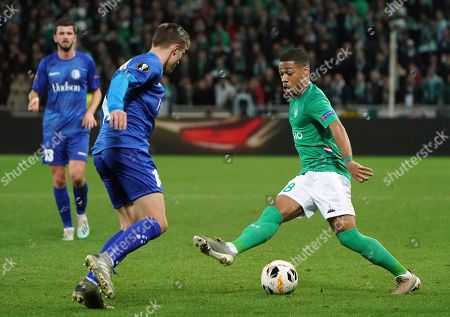 Saint-Etienne's Arnaud Nordin, right, duels for the ball with Gent's Alessio Castro-Montes during the Europa League group I soccer match between Saint Etienne and Gent at Geoffroy Guichard stadium in Saint Etienne, central France