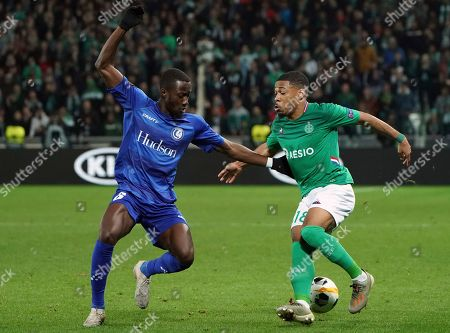 Stock Photo of Saint-Etienne's Arnaud Nordin, right, duels for the ball with Gent's Elisha Owusu during the Europa League group I soccer match between Saint Etienne and Gent at Geoffroy Guichard stadium in Saint Etienne, central France