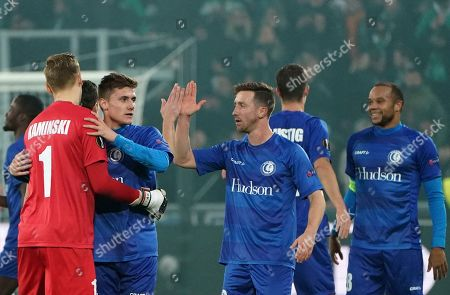 Stock Image of Gent players celebrate at the end of the Europa League group I soccer match between Saint Etienne and Gent at Geoffroy Guichard stadium in Saint Etienne, central France