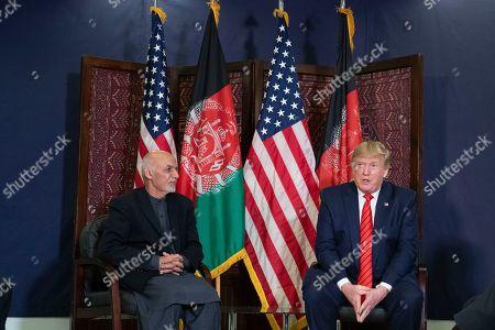 Donald Trump, Ashraf Ghani. President Donald Trump, right, meets with Afghan President Ashraf Ghani, left, during Trump's surprise Thanksgiving Day visit, at Bagram Air Field, Afghanistan