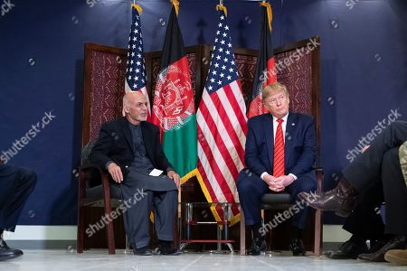 Donald Trump, Ashraf Ghani. President Donald Trump, right, meeting with Afghan President Ashraf Ghani, left, during a surprise Thanksgiving Day, at Bagram Air Field, Afghanistan