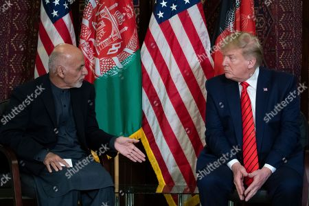 Donald Trump, Ashraf Ghani. President Donald Trump listens during a meeting with Afghan President Ashraf Ghani during a surprise Thanksgiving Day visit, at Bagram Air Field, Afghanistan