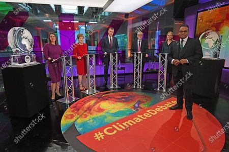 (L-R) Liberal Democrat leader Jo Swinson, SNP leader Nicola Sturgeon, Plaid Cymru leader Adam Price, Labour Party leader Jeremy Corbyn and Green Party Co-Leader Sian Berry, and British journalist Krishnan Guru-Murthy in the foreground in the studio before the start of the Channel 4 News' General Election climate debate at ITN Studios in Holborn, central London, Britain, 28 November 2019.