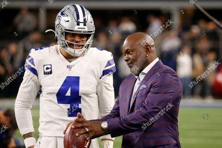 Dallas Cowboys quarterback Dak Prescott (4) talks with former player Emmitt Smith, right, during warmups before an NFL football game against the Buffalo Bills in Arlington, Texas