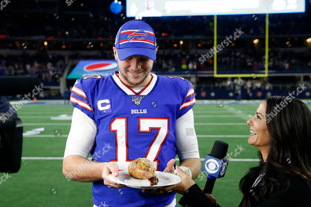 Buffalo Bills quarterback Josh Allen (17) is presented with a turkey leg by CBS sideline reporter Tracy Wolfson after an NFL football game against the Dallas Cowboys in Arlington, Texas, . Buffalo won the game 26-15