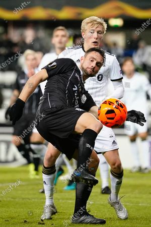Stock Image of James Holland of LASK (front) with the ball during the Europa League group D match Rosenborg BK vs LASK Linz in Lerkendal Stadium in Trondheim, Norway, 28 November, 2019.