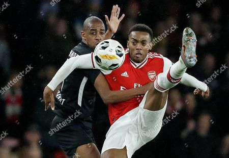 Frankfurt's Gelson Fernandes, left, and Arsenal's Joe Willock, right, challenge for the ball during the Europa League Group F soccer match between Arsenal and Eintracht Frankfurt at the Emirates Stadium, in London
