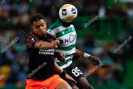 Stock Image of PSV's Donyell Malen, left, battles for the ball with Sporting's Yannick Bolasie during the Europa League group D soccer match between Sporting CP and PSV Eindhoven at the Alvalade stadium in Lisbon