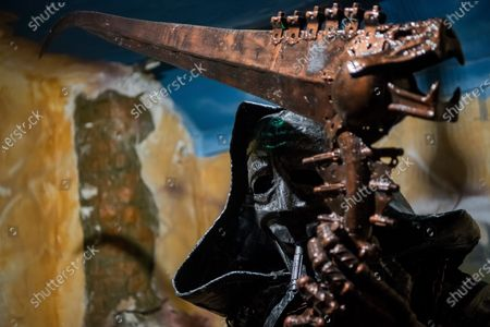 A scuplture of the Grim Reaper made of used car spare parts is seen at an exhibition of the Amazing Metal Art Gallery in Budapest, Hungary, 28 November 2019.