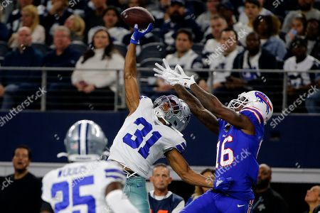Dallas Cowboys safety Xavier Woods (25) looks on as cornerback Byron Jones (31) breaks up a pass intended or Buffalo Bills wide receiver Robert Foster (16) in the first half of an NFL football game in Arlington, Texas