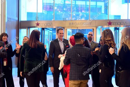 Stock Image of Jeff Gennette, center, Chairman and CEO of Macy's, Inc., prepares for Macy's Herald Square to open its doors at 5 p.m. on Thanksgiving Day for thousands of Black Friday shoppers, in New York