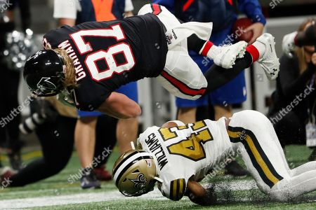 New Orleans Saints free safety Marcus Williams (43) tackles Atlanta Falcons tight end Jaeden Graham (87) during the second half of an NFL football game, in Atlanta
