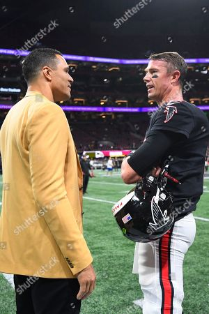 Former NFL player and Football Hall of Fame member Tony Gonzalez, left, speaks with Atlanta Falcons quarterback Matt Ryan before the first half of an NFL football game between the Atlanta Falcons and the New Orleans Saints, in Atlanta