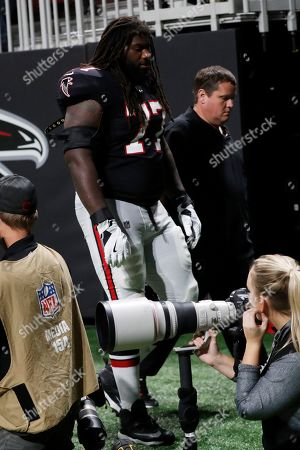 Atlanta Falcons offensive guard James Carpenter (77) leaves the field during the first half of an NFL football game between the Atlanta Falcons and the New Orleans Saints, in Atlanta