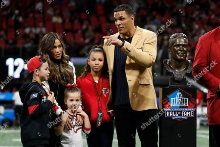 Stock Photo of Former NFL player and Football Hall of Fame member Tony Gonzalez stands with his family as he was celebrated on the field at half time of an NFL football game between the Atlanta Falcons and the New Orleans Saints, in Atlanta