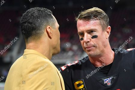 Former NFL player and Football Hall of Fame member Tony Gonzalez speaks with Atlanta Falcons quarterback Matt Ryan before the first half of an NFL football game between the Atlanta Falcons and the New Orleans Saints, in Atlanta