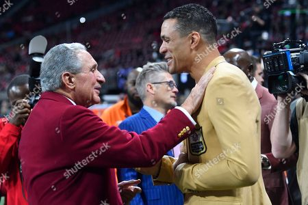 Atlanta Falcons owner Arthur Blank, left, speaks with former NFL player and Football Hall of Fame player Tony Gonzalez before the first half of an NFL football game between the Atlanta Falcons and the New Orleans Saints, in Atlanta