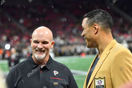 Former NFL player and Football Hall of Fame member Tony Gonzalez speaks with Atlanta Falcons head coach Dan Quinn before the first half of an NFL football game between the Atlanta Falcons and the New Orleans Saints, in Atlanta