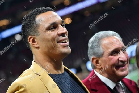 Atlanta Falcons owner Arthur Blank, right, speaks with former NFL player and Football Hall of Fame player Tony Gonzalez before the first half of an NFL football game between the Atlanta Falcons and the New Orleans Saints, in Atlanta