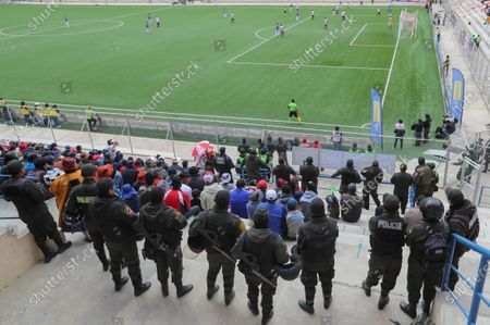 Police officers watch over Club Always Ready's fans during a match against Jorge Wilstermann at the Municipal Stadium of El Alto, Bolivia, 28 November 2019. Soccer was played again in El Alto, one of the Bolivian cities most affected by the conflict that the country has suffered in the wake of the resignation of former president Evo Morales.