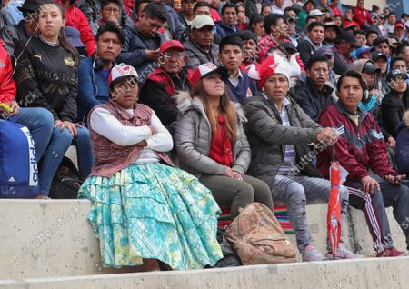 Club Always Ready's fans watch a game against Jorge Wilstermann at the Municipal Stadium of El Alto, Bolivia, 28 November 2019. Soccer was played again in El Alto, one of the Bolivian cities most affected by the conflict that the country has suffered in the wake of the resignation of former president Evo Morales.