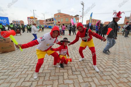 Club Always Ready's fans, dressed as Chapulin Colorado, the emblematic character popularized by Mexican comedian Roberto Gomez Bolanos, attend a soccer match at the Municipal Stadium of El Alto, Bolivia, 28 November 2019. Soccer was played again in El Alto, one of the Bolivian cities most affected by the conflict that the country has suffered in the wake of the resignation of former president Evo Morales.