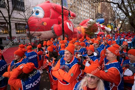 Snoopy balloon handlers gather before the Macy's Thanksgiving Day Parade, in New York