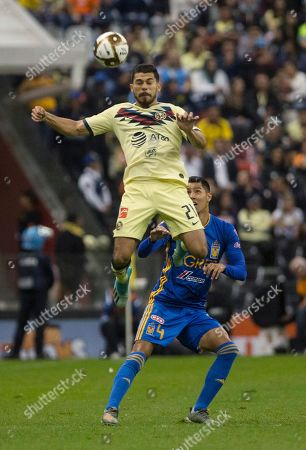 CP. America's Josue Martin, top, heads the ball in front of Tigres' Hugo Ayala during a Mexico soccer league match in Mexico City