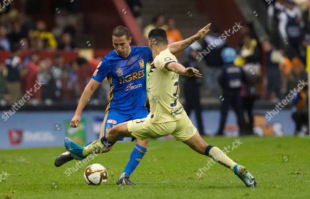 CP. Tigres' Jesus Duenas, left, competes for the ball with America's Eduardo Sanchez during a Mexico soccer league match in Mexico City