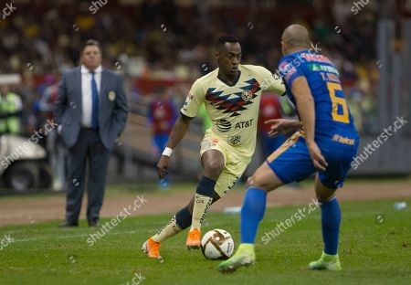 CP. America's Renato Ibarra, right, competes for the ball with Tigres' Jorge Torres Nilo during a Mexico soccer league match in Mexico City