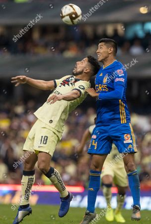 CP. America's Bruno Valdez, left, and Tigres' Hugo Ayala try to head the ball during a Mexico soccer league match in Mexico City