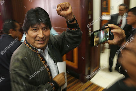 Bolivia's former President Evo Morales pumps his fist after a press conference at the journalists club in Mexico City. Morales went into exile in Mexico after he was prodded by police and the military, forcing him to resigned on Nov. 10, after he claimed victory in an election that international observers invited in by the government said was marred by numerous irregularities