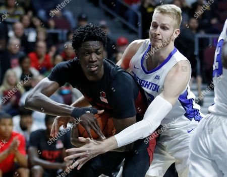 San Diego State's Nathan Mensah, left, steals the ball from Creighton's Kelvin Jones (43) during the first half of an NCAA college basketball game, in Las Vegas