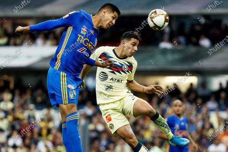 Jorge Sanchez (R) of Club America in action against Hugo Ayala (L) of Tigres UANL during the 2019 Apertura Tournament quarterfinals first leg soccer match between Club America and Tigres UANL, at the Azteca Stadium in Mexico City, Mexico, 28 November 2019.