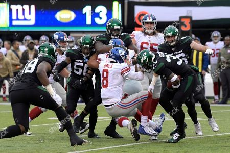 New York Jets strong safety Jamal Adams, right, strips the ball from New York Giants quarterback Daniel Jones, left, during the second half of an NFL football game, in East Rutherford, N.J. Adams scored a touchdown on the play