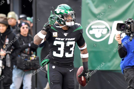 New York Jets strong safety Jamal Adams celebrates after stripping the ball from New York Giants quarterback Daniel Jones and scoring a touchdown during the second half of an NFL football game, in East Rutherford, N.J