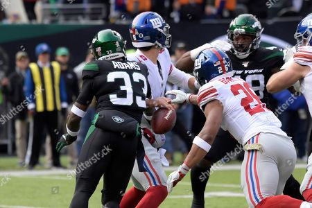 New York Jets strong safety Jamal Adams (33) strips the ball from New York Giants quarterback Daniel Jones (8) during the first half of an NFL football game, in East Rutherford, N.J