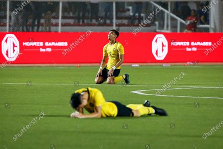 Malaysian players Muhammad Hadi Fayyadh Abdul Razak (back) and Dominic Tan (front) react after the SEA Games 2019 men's first round soccer match between the Philippines and Malaysia in Manila, Philippines, 29 November 2019.