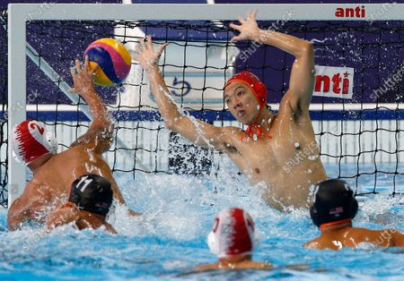 Beby Willy Eha Pahsi Tarigan (L) of Indonesia in action against Chee Huan Song (R) of Malaysia during a SEA Games 2019 Water Polo Men's Round Robin match at the New Clark City Aquatics Center in Tarlac province, north of Manila, Philippines, 29 November 2019.
