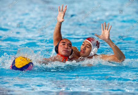 Kay Chun Hong (L) of Malaysia in action against Ridjkie Mulia (R) of Indonesia during a SEA Games 2019 Water Polo Men's Round Robin match at the New Clark City Aquatics Center in Tarlac province, north of Manila, Philippines, 29 November 2019.
