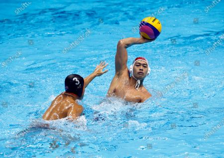 Bryan Ming Jie Wong (L) of Malaysia in action against Ridjkie Mulia (R) of Indonesia during a SEA Games 2019 Water Polo Men's Round Robin match at the New Clark City Aquatics Center in Tarlac province, north of Manila, Philippines, 29 November 2019.