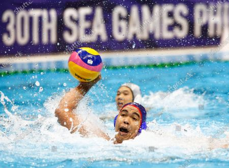 Mummar Almara of the Philippines in action against Singapore during the SEA Games 2019  men's Water Polo round robin match at the New Clark City Aquatics Center near Capas, Philippines, 29 November 2019.