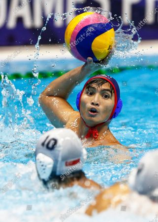 Reynaldo Salonga Jr (back) of the Philippines in action against Tang Yee Heng (front) of Singapore during the SEA Games 2019  men's Water Polo round robin match at the New Clark City Aquatics Center near Capas, Philippines, 29 November 2019.
