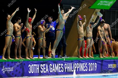 Players of the Philippines celebrate after defeating Singapore in their SEA Games 2019 men's Water Polo round robin match at the New Clark City Aquatics Center near Capas, Philippines, 29 November 2019.