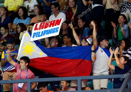 Stock Image of Fans of the Philippines cheer during the SEA Games 2019 men's Water Polo round robin match between the Philippines and Singapore at the New Clark City Aquatics Center near Capas, Philippines, 29 November 2019.