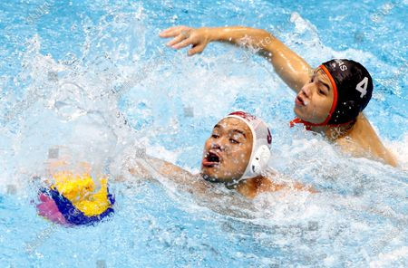 Stock Picture of Delvin Fellicino (L) of Indonesia in action against Toh Yi Xiang (R) of Malaysia during a SEA Games 2019 Water Polo Men's Round Robin match at the New Clark City Aquatics Center in Tarlac province, north of Manila, Philippines, 29 November 2019.
