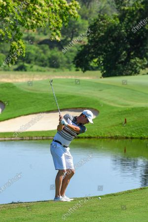Stock Image of Sweden's Alexander Bjork plays a shot on the 13th on the second day of the Alfred Dunhill Championship at the Leopard Creek Golf Course in Nelspruit, South Africa, 29 November 2019.