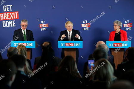 Britain's Prime Minister Boris Johnson, center, speaks during a media conference with Chancellor of the Duchy of Lancaster Michael Gove, left, and ex-Labour minister Gisela Stuart in London, . Britain goes to the polls on Dec. 12