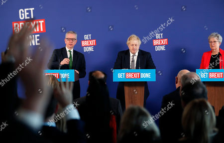 Britain's Prime Minister Boris Johnson, center, Chancellor of the Duchy of Lancaster Michael Gove, left, and ex-Labour minister Gisela Stuart attend a media conference in London, . Britain goes to the polls on Dec. 12